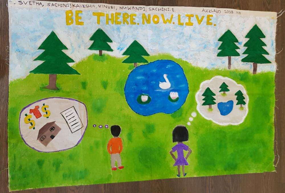 "Artwork by student saying ""Be there. Now. Live."""